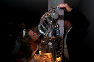 HAND AND BOTTLE ICE VODKA LUGE