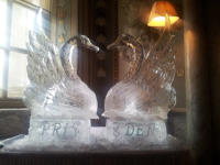 LARGE SWANS ON ICE PLINTHS